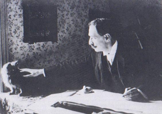 Louis_Wain_at_his_drawing_table_1890 terza
