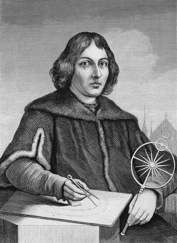 Engraved portrait of Polish astronomer Nicolas Copernicus (1473 - 1543) drawing the sun as the center of the universe. (Photo by Kean Collection/Getty Images)